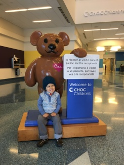 Amos cheesing with CHOC-o bear while we get checked in for a transfusion.