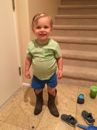 Luke love Amos' cowboy boots, even when they are on the wrong feet!