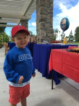 Waiting for his birthday party to get started.