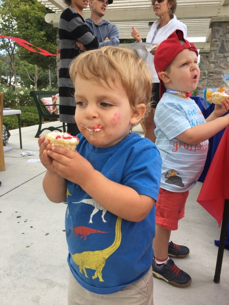 Celebrating at Amos's birthday party - Baseball cupcakes for the win