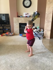 Amos has been watching some Angels baseball and working on his Mike Trout stance.