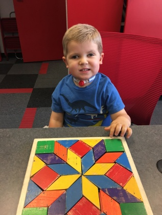 Amos showing off the puzzel that he completed with Dr. Rakov, his vision therapist. Way to go Amos!