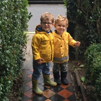Brothers heading off to stomp in the puddles!