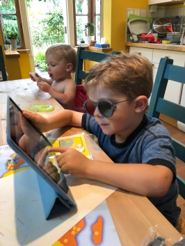 Amos doing some of his vision therapy games on the iPad