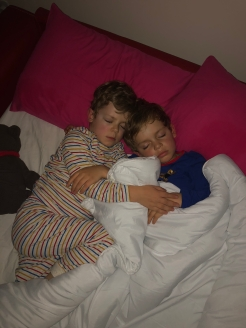 The boys, sleeping in a sofa bed the night before we left Cambridge.